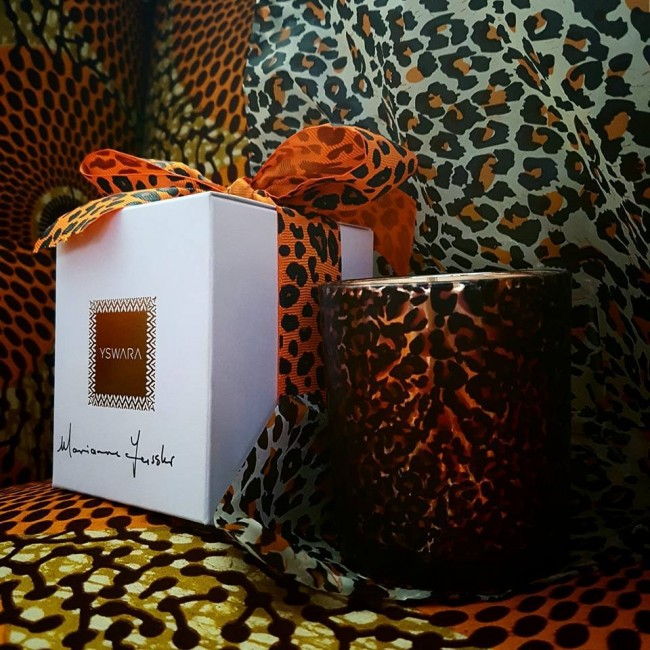 Orange and clove aromatherapy candle for Orange Babies designed by iconic South African fashion designer Marianne Fassler and luxury African brand YSWARA
