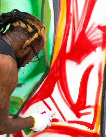 Cameroon artist painting a wall