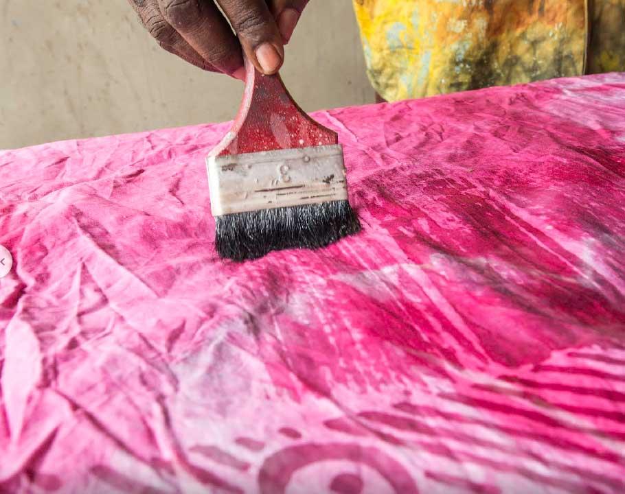 Handmade Batik In Ghana brushing the cloth with wax