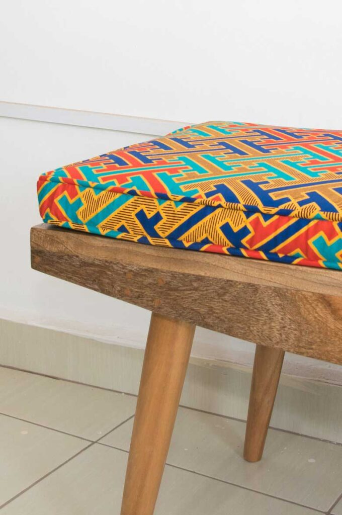 Workshop Nairobi Stalled bench with African print fabric cushions